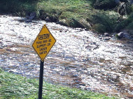 Caution, Trail May be Slippery or Under Water