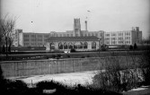 West High School, located at West 10th Ave. and Elati Street, is seen from the north bank of Cherry Creek, DPL Western History Collection Rh-640