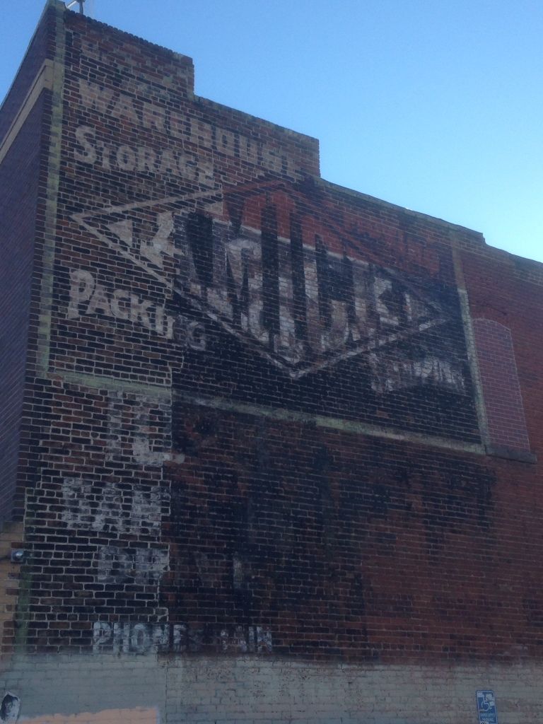 Faded legacy of the Amick  Storage and Transfer Co.'s painted sign.